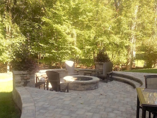 circular fire pit in backyard patio