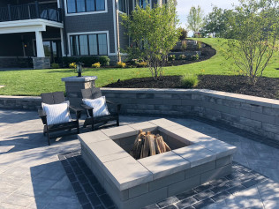 square shaped fire pit in backyard patio